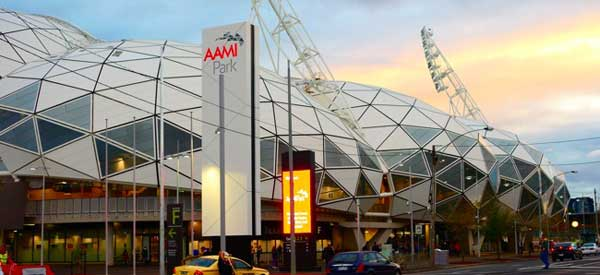 The bobbly exterior of AAMI Stadium as seen from across the road at dusk.