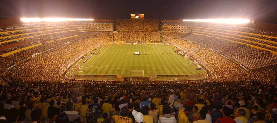 Inside Estadio Monumental Isidro Romero Carbo at night