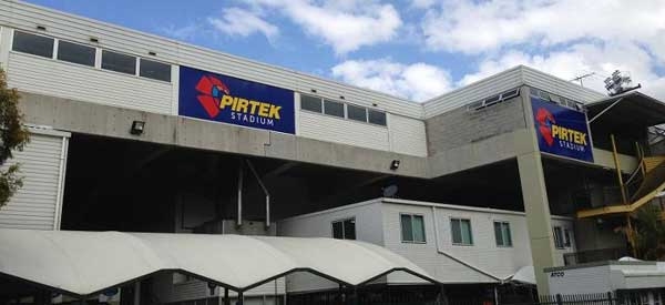 The exterior of one of the large side stands complete with Pirtek sign.