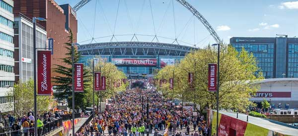 The famous Wembley Walkway. You can see great external view of the stadium and its arch in all its glory.