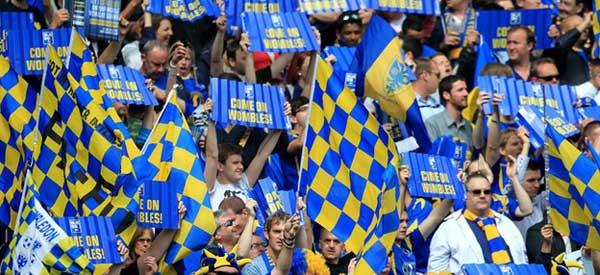 AFC Wimbledon Fans at Stadium MK for the FA Cup match against the contentiously formed Milton Keynes Dons.