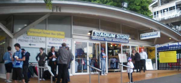 The stadium store at Allianz Stadium with a similarly curved roof to the stands.