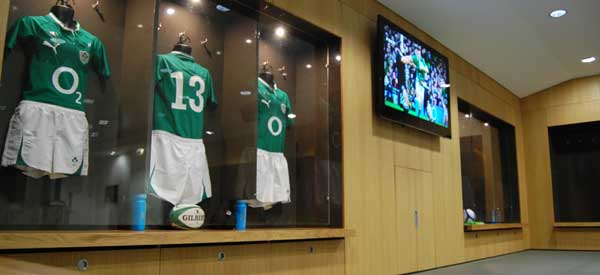 Inside the home dressing room with Irish rugby kits on display.