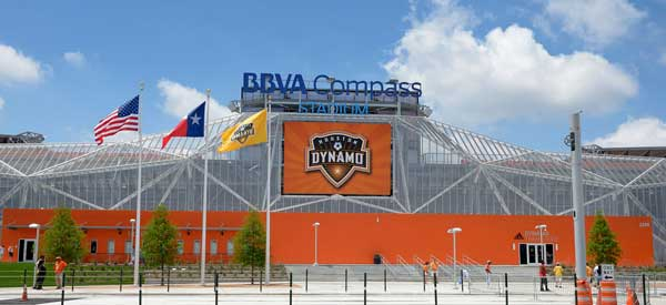An outside look at the vivid exterior of BBVA Compass Stadium which is a brilliant blend of orange and steel.