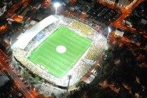 Night time view of Bloomfield stadium from the sky