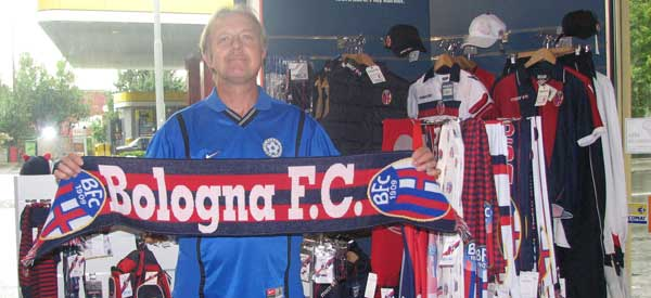 Bologna FC's Club Shop with a scarf holding fan!
