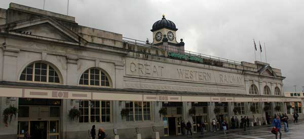 The classy exterior of Cardiff Central Railway Station complete with typical British Weather.