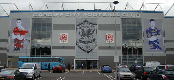 The exterior of Cardiff City Stadium which is still somehow graced with a touch of blue at the top.