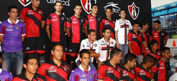 Players inside Club Atlas club shop