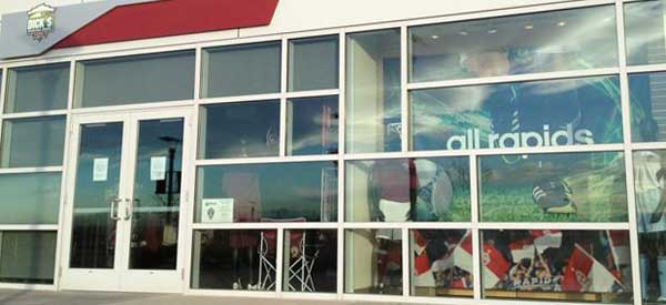 A very poorly cropped close up of the Rapids Team Store.
