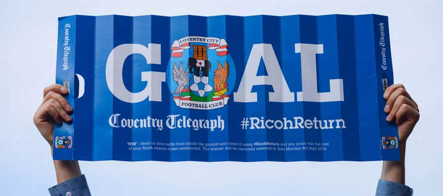 Coventry City fan holds up sign for Ricoh Arena