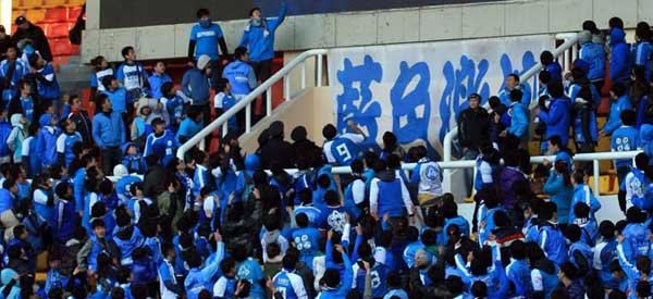 Dalian aerbin FC supporters inside the stadium