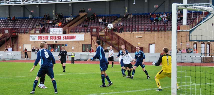 Ongoing football match at Deeside Stadium