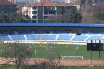 Game in progress at FK Novi Pazar Stadium