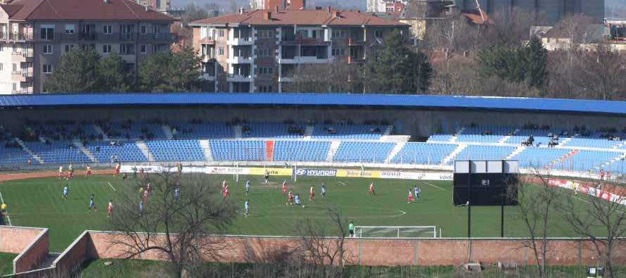 Game in progress at FK Novi Pazar Stadium