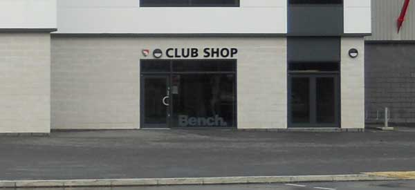 The exterior of the club shop located within The Peter McGuigan Stand to the right of reception.