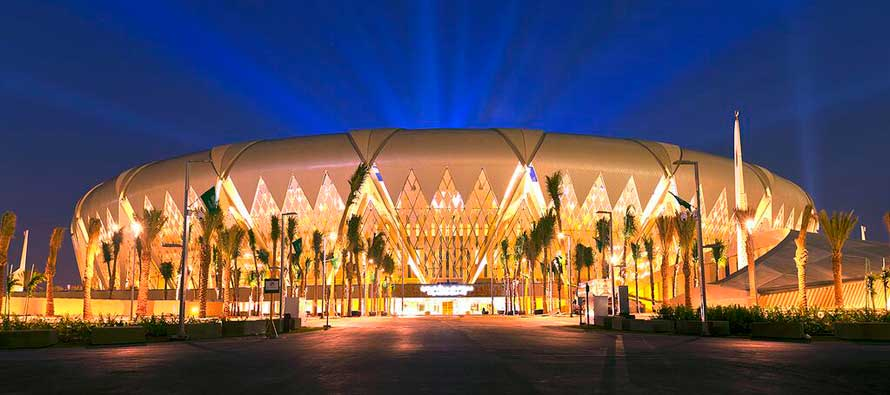 Nightime exterior view of King Abdullah Stadium