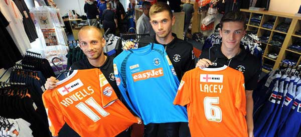 Luton FC players posing with new home shirt