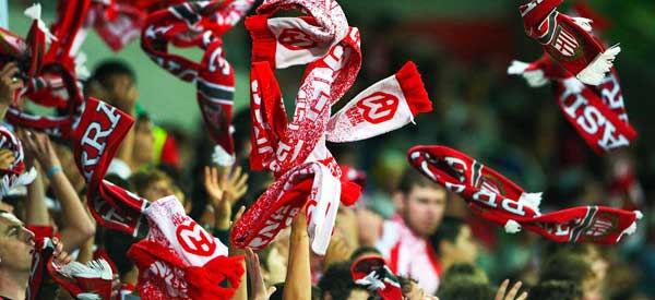 Melbourne City fans waving their red scarves.