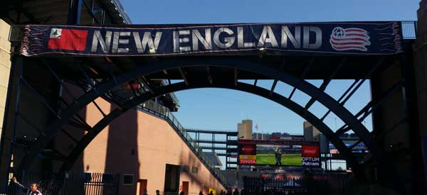 A New England Sign proudly placed above the stadium's main entrance.