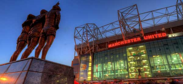 Exterior of Old Trafford at night