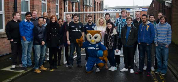 A few fans posing with the famous Oldham Owl