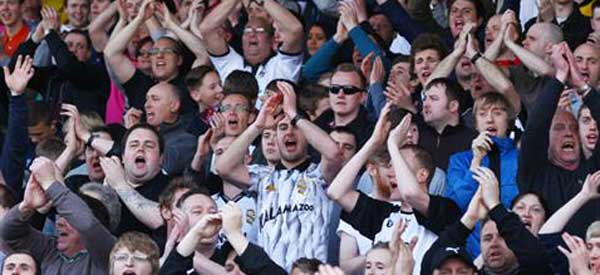Port Vale fans cheering their boys in Blue...and white