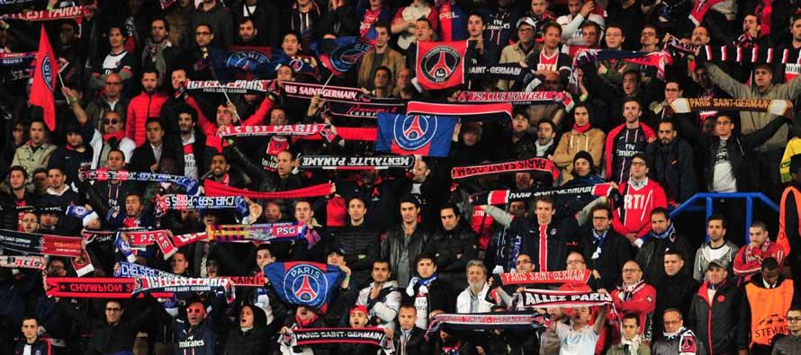 PSG fans holding scarves