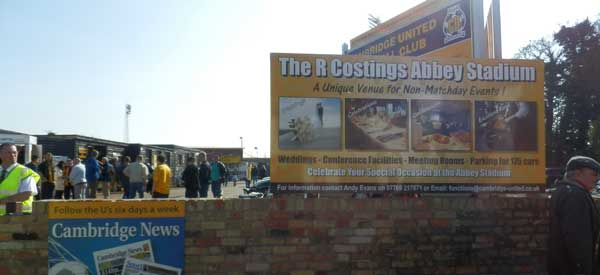 The entrance sign to R Costings Abbey Stadium.