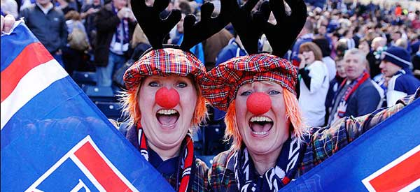 Two Ross County fans fully embracing some of the amusing yet factually incorrect Scottish stereotypes.