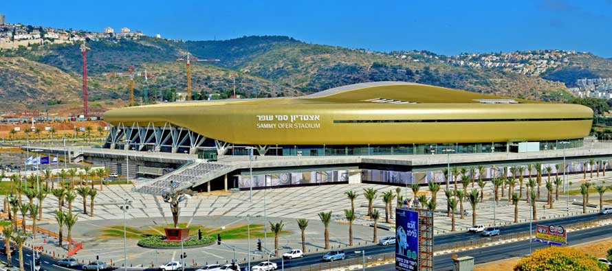 Gold exterior of Sammy Ofer Stadium
