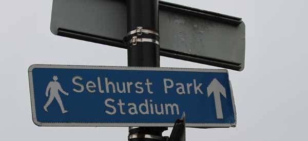 A sign for those walking to Selhurst Park indicating that the ground is straight ahead.