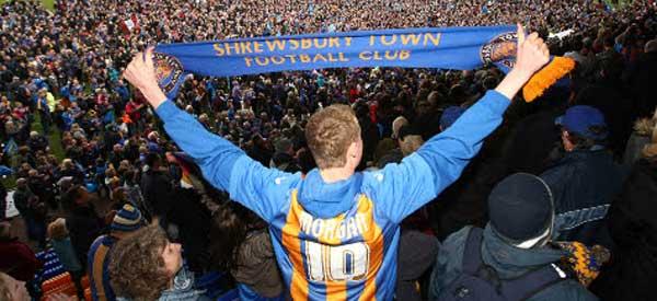Shrewsbury fan holding up scarve