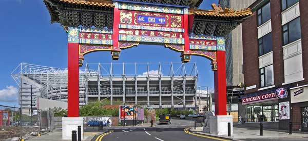 St James Park as seen through Newcastle's Chinatown Arch which was erected in 2004.