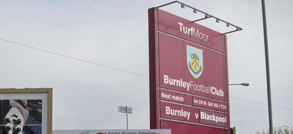 A sign marking the entrance to Burnley's Turf Moor Stadium.