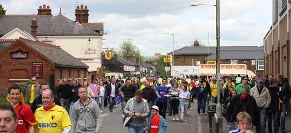 Fans walking down Vicarage Road