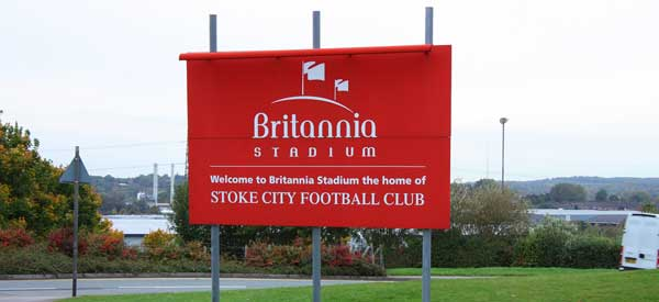 "A sign which reads ""Welcome to Britannia Stadium, the home of Stoke City Football Club"""